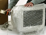 Old computer screen in bubble wrap.